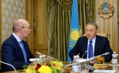 President Nursultan Nazarbayev meets with the chairman of the National Bank, Kayrat Kelimbetov, to discuss the bank's performance and plans. Analysts raise questions about the reasons for Kazakhstan's national wealth fund's sale of a 10 percent stake in the state energy company to the National Bank, wondering if the bank was pressured to accept the deal and how well Kazakhstan is coping with a slowdown in economic growth. (Photo: Kazakhstan Presidential Press Service)