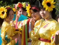 Some young girls from Kazakhstan wearing yellow traditional dresses (Image by Mark Andrew Barrett)